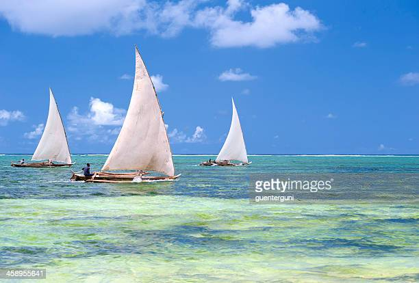 Fisherman in their Dhow boat at the coast of Zanzibar