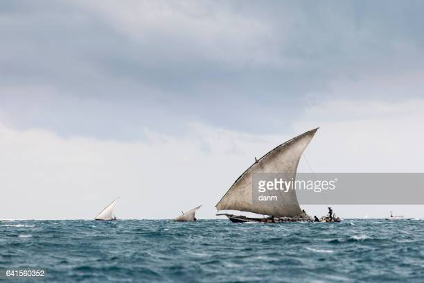 Fisherman in Zanzibar going to fish in morning with storm clouds