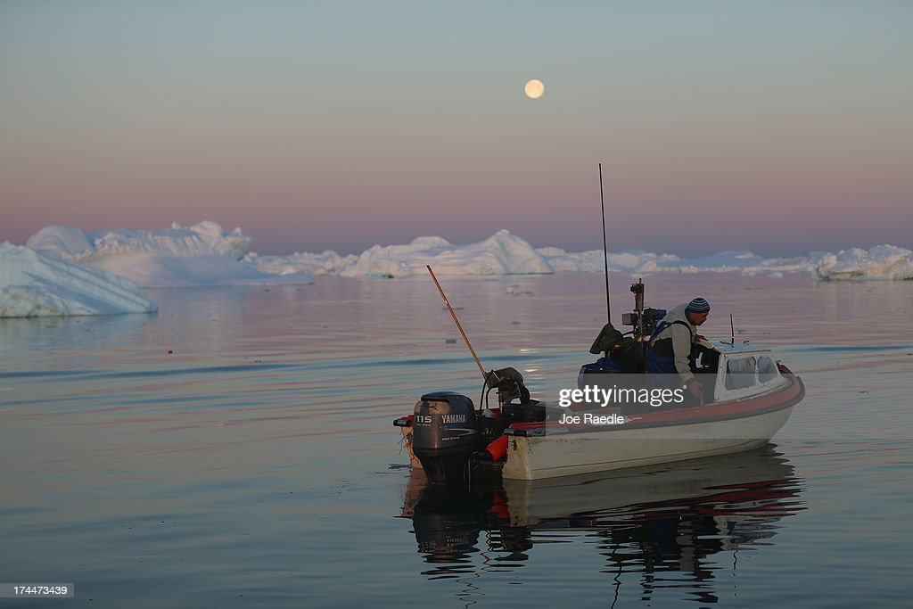 Fisherman, Inunnguaq Petersen, waits for fish to catch on the line he put out near icebergs that broke off from the Jakobshavn Glacier on July 23, 2013 in Ilulissat, Greenland. As the sea levels around the globe rise, researchers affilitated with the National Science Foundation and other organizations are studying the phenomena of the melting glaciers and its long-term ramifications. The warmer temperatures that have had an effect on the glaciers in Greenland also have altered the ways in which the local populace farm, fish, hunt and even travel across land. In recent years, sea level rise in places such as Miami Beach has led to increased street flooding and prompted leaders such as New York City Mayor Michael Bloomberg to propose a $19.5 billion plan to boost the citys capacity to withstand future extreme weather events by, among other things, devising mechanisms to withstand flooding.