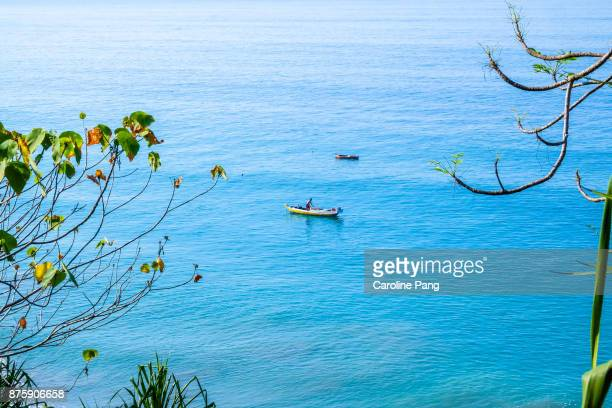Fisherman is fishing in the deep blue Savu Sea off the coast of Ende in Flores Indonesia.