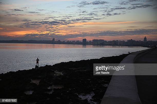 A fisherman is seen along the Malecon as Cuba prepares for the visit of US president Barack Obama on March 18 2016 in Havana Cuba Mr Obama's visit on...