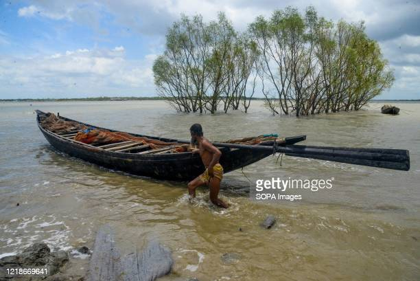 Fisherman is seen preparing to catch fish during the aftermath. Thousands of shrimp enclosures have been washed away, while numerous thatched house,...