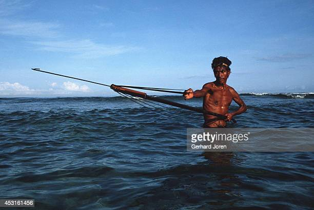 A fisherman loads his harpoon near the capital Dili