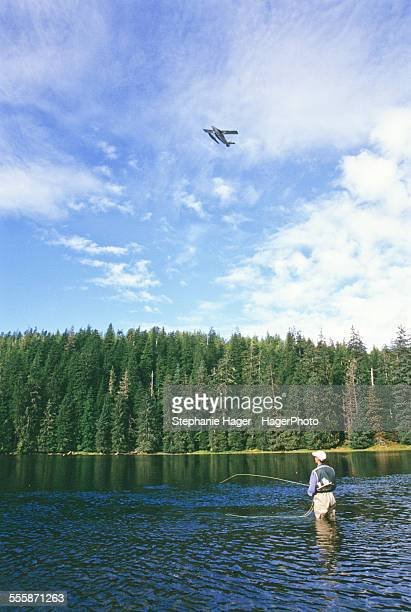 Fisherman looking at plane