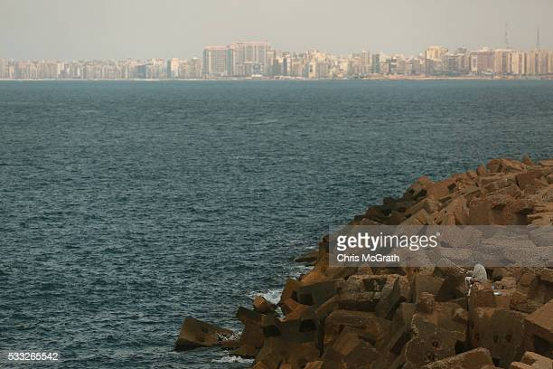 A fisherman looks out over the Mediterranean Sea from the coastline of Alexandria where about 290 kilometers north search operations are taking place...