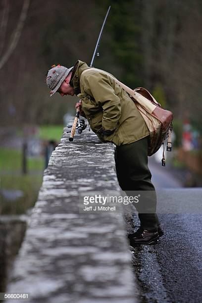 Fisherman looks over the bridge at the River Tay on the opening day of the salmon season on January 16, 2006 in Kenmore, Scotland. The season is...