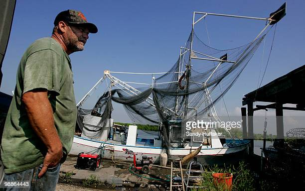 Fisherman Milton Schacki stands next to his shrimping boat on May 5 2010 in Delacroix Louisiana Many local fishermen have been temporarily shut down...