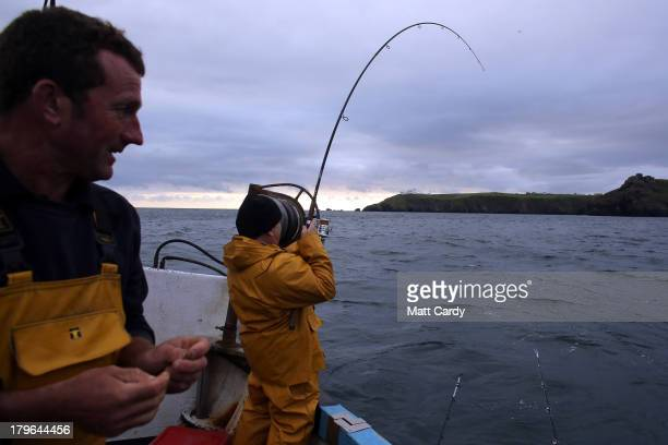 Fisherman Nick Casely fishes for bass close to the Lizard penisula as he takes part in the final Cadgwith Cove fortnightly fishing competition of the...