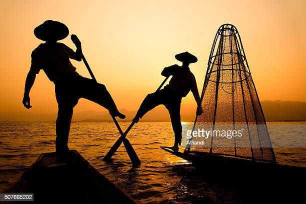 a fisherman of inle lake, myanmar - myanmar culture stock pictures, royalty-free photos & images