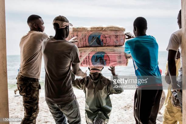 Fisherman offloads fish meant to be exported at the export side of the Hann - Bel Air fishing docks in Dakar on April 3, 2020. - Usually bustling...