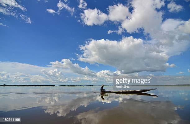 fisherman on bangladeshi lake - bangladesh nature stock photos and pictures