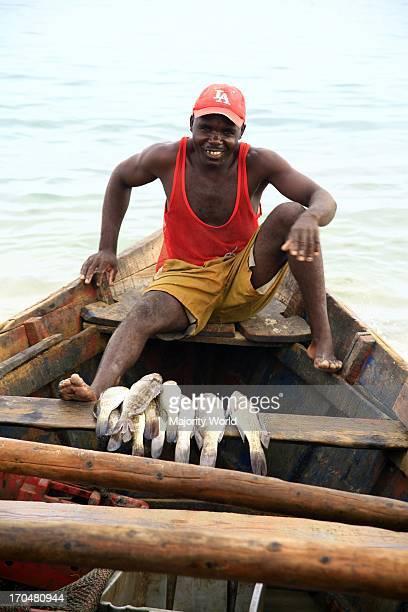 Fisherman on his boat near the village of Baia Farta, in Angola. April 20, 2007.