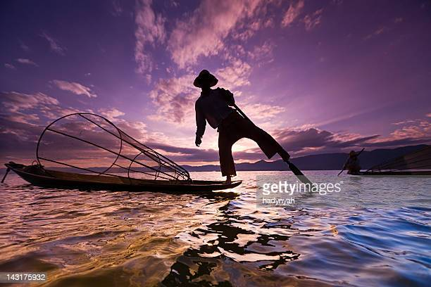 fisherman on inle lake, myanmar - myanmar culture stock pictures, royalty-free photos & images