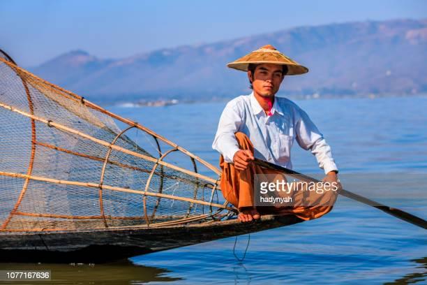 fisherman on inle lake, shan state, myanmar - myanmar stock pictures, royalty-free photos & images