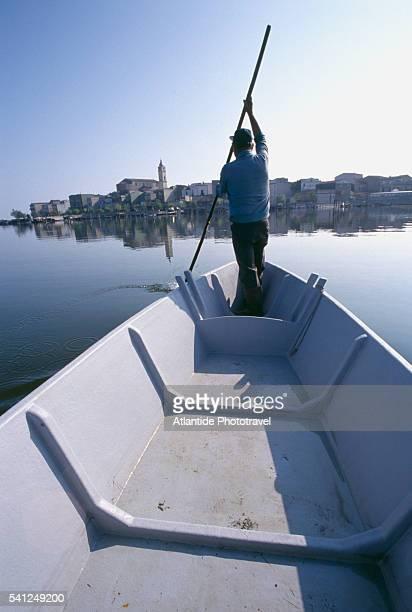 fisherman on lesina lake - les pouilles photos et images de collection