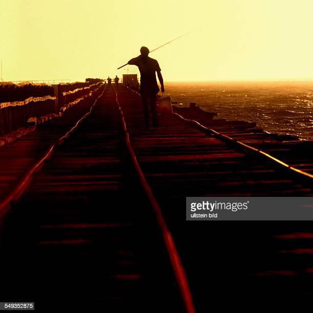 Fisherman on the 1 mile jetty Carnarvon Northwest Australia