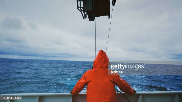 Fisherman on the fishing boat deck