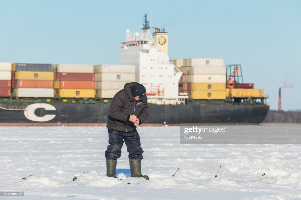 Heavy frozen in russia photos and images getty images fisherman on the ice of the gulf of finland during severe frost saint petersburg publicscrutiny Gallery