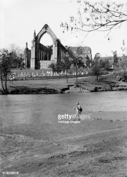 A fisherman on the River Wharfe in front of the ruins of Bolton Priory North Yorkshire 1940