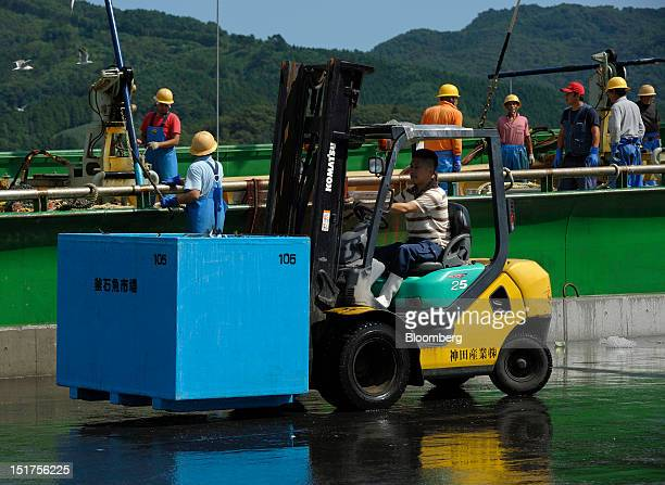 A fisherman operates a forklift truck as others work on a trawler at a port in Ofunato City Iwate Prefecture Japan on Friday Sept 7 2012 Japan's...