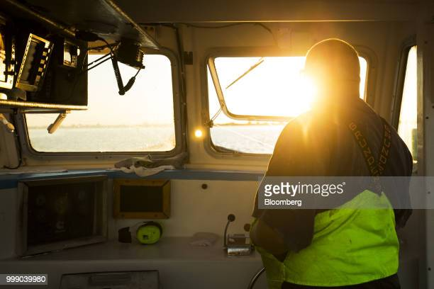 A fisherman packs lobsters into a container on a boat off the coast of Plymouth Massachusetts US on Tuesday July 10 2018 The proposed tariffsbetween...