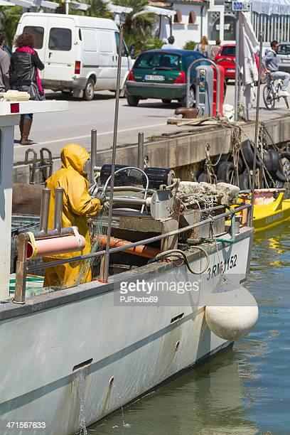 Fisherman prepare the fishing net at port