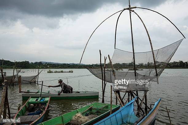 A fisherman prepares to go out on a lake formed in an abandoned open pit coal mine As more mines close these lakes become an environmental hazard as...