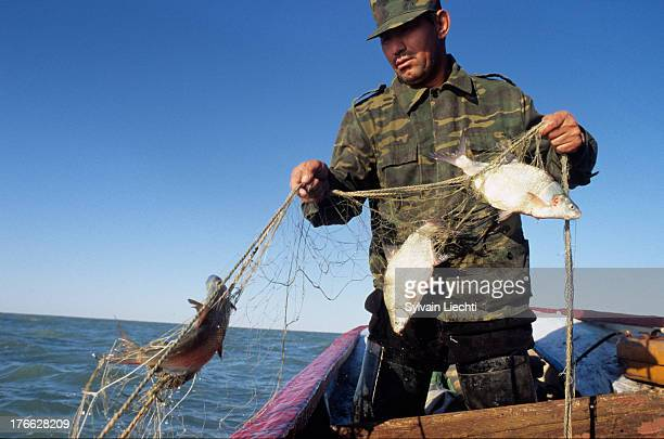 CONTENT] A fisherman pulls in his nets on the northern part of Aral sea near Aralsk in Kazakhstan The building of a dyke on dried out Aral sea...