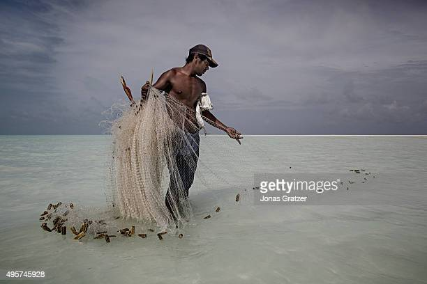 A fisherman putting out his nets in North Tarawa Fish is the main diet of the people but in recent years the fish population has decreased in the...