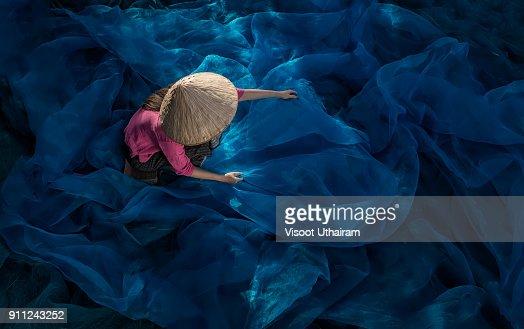 Fisherman repair fishing net.