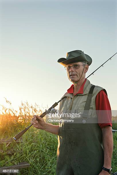Fisherman Returning From Fishing Trip Surrounded By Reeds.