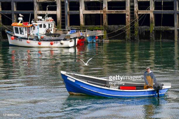 A fisherman returns to the harbour in Scarborough UK on Tuesday June 2 2020 The threat of a nodeal Brexit is back and with it the risk that the UK...
