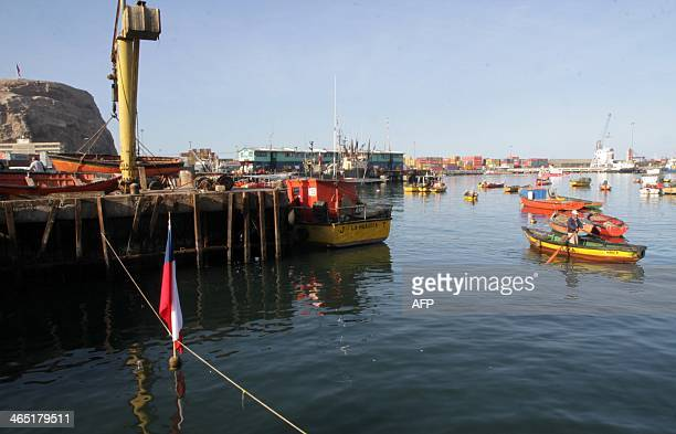 A fisherman rows his boat at the port of Arica Chile close to the border with Peru and about 2100 km north of Santiago on January 262014 Both...