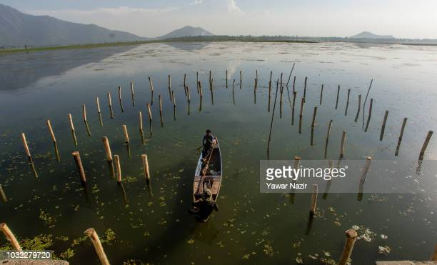 A fisherman rows his boat in Dal lake on September 12 2018 in Srinagar the summer capital of Indian administered Kashmir India Kashmir the Muslim...