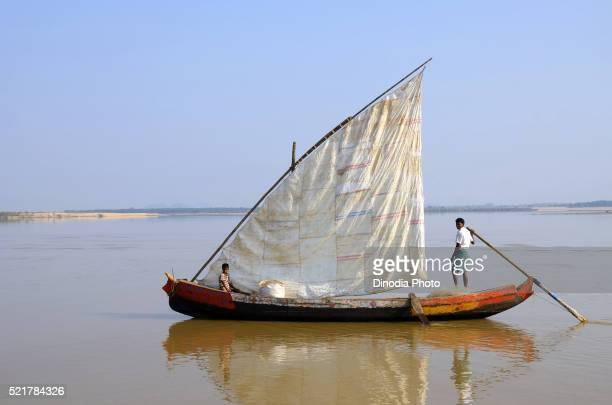 Fisherman sailing boat River Godavari, Rajahmundry, Andhra Pradesh, India