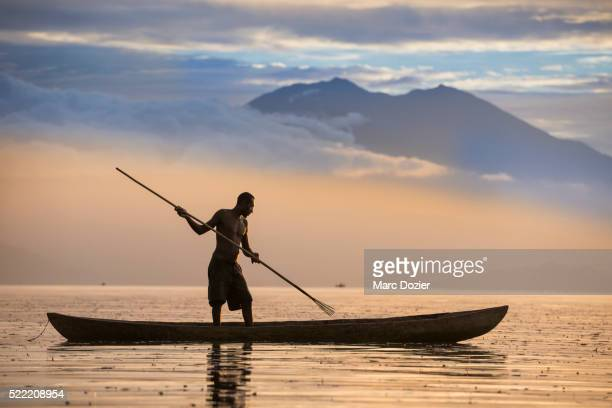fisherman shadow - papua new guinea stock pictures, royalty-free photos & images