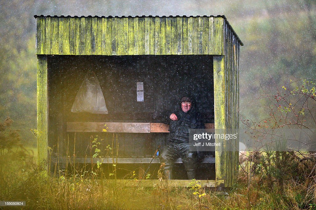 A fisherman shelters next to the Etterick river near to the fish ladder on October 31, 2012 in Selkirk, Scotland. Salmon are returning upstream from the sea where they have spent between two and four winters feeding with many covering huge distances to return to the fresh waters to spawn.