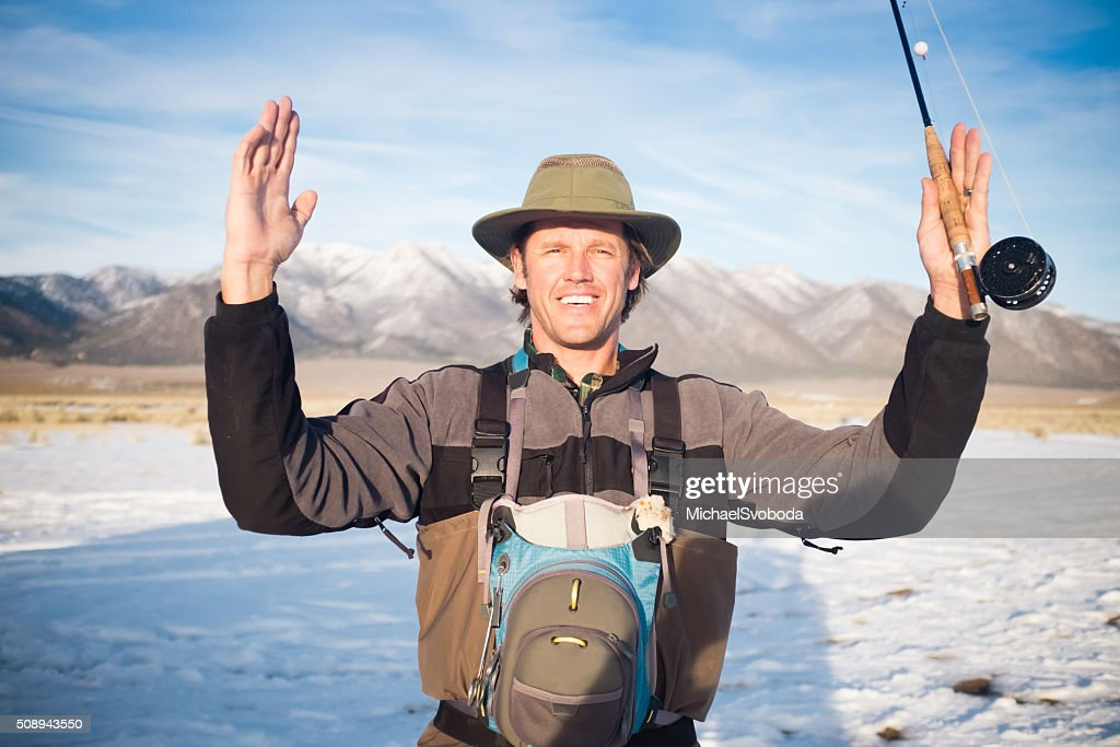 Fisherman Showing How Big The Fish That Got Away Was : Stock Photo