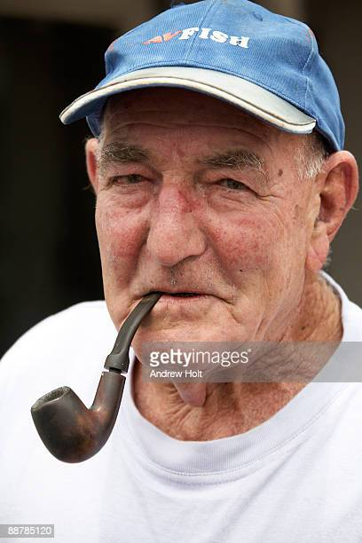 Fisherman smoking a  pipe in Sydney, Australia.