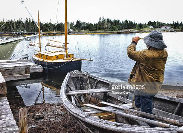Fisherman Standing in a Dory with Telescope, Nova Scotia.