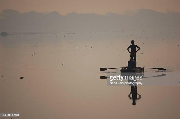 Fisherman standing in boat