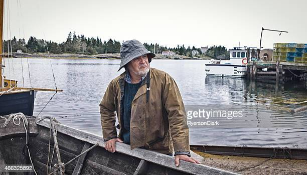 Fisherman Standing Near a Dory, Mahone Bay, Nova Scotia