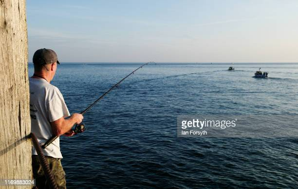 A fisherman stands on the end of Whitby West pier as fishing charters head out to sea on August 24 2019 in Whitby England Temperatures are expected...