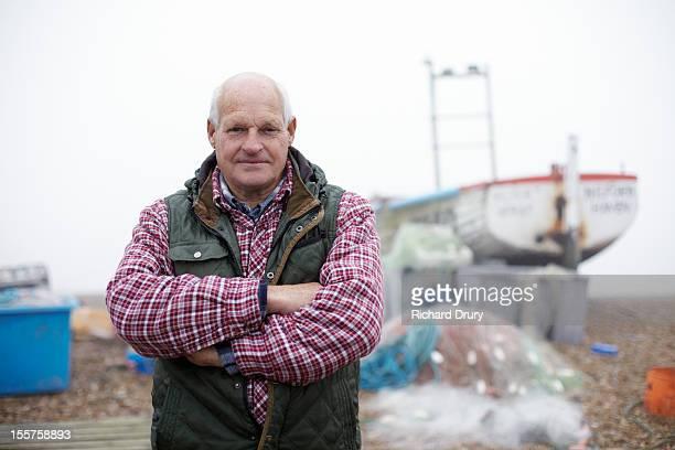 fisherman stood by fishing boat - homme chauve photos et images de collection