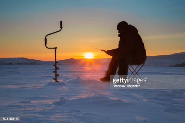 fisherman subglacial fishing - ice fishing stock pictures, royalty-free photos & images
