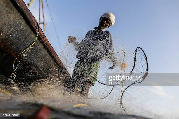 A fisherman tends to his net near the Fort Kochi Chinese fishing nets in Cochin Kerala India on Friday May 29 2015 UBS Group AG says India has room...