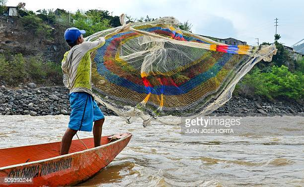A fisherman throws his net in the Magdalena River in Honda Tolima department Colombia on February 9 2016 Affected by El Nino the Magdalena Colombia's...