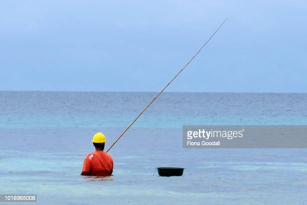 A fisherman tries his luck in the lagoon on August 15 2018 in Funafuti Tuvalu Fish are an important food source on the island with mainly tuna caught...