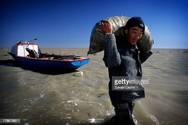 CONTENT] A fisherman unload his daily catch on the shores of Aral sea near Aralsk Kazakhstan the 10th of September 2007 The building of a dyke on...