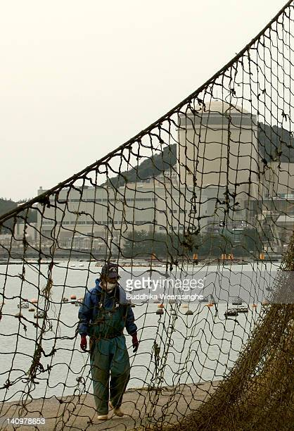 A fisherman walks in front of the Mihama No 3 reactor which is run by Kansai Electric Power Co on March 8 2012 in Mihama Japan Only two of Japan's 54...